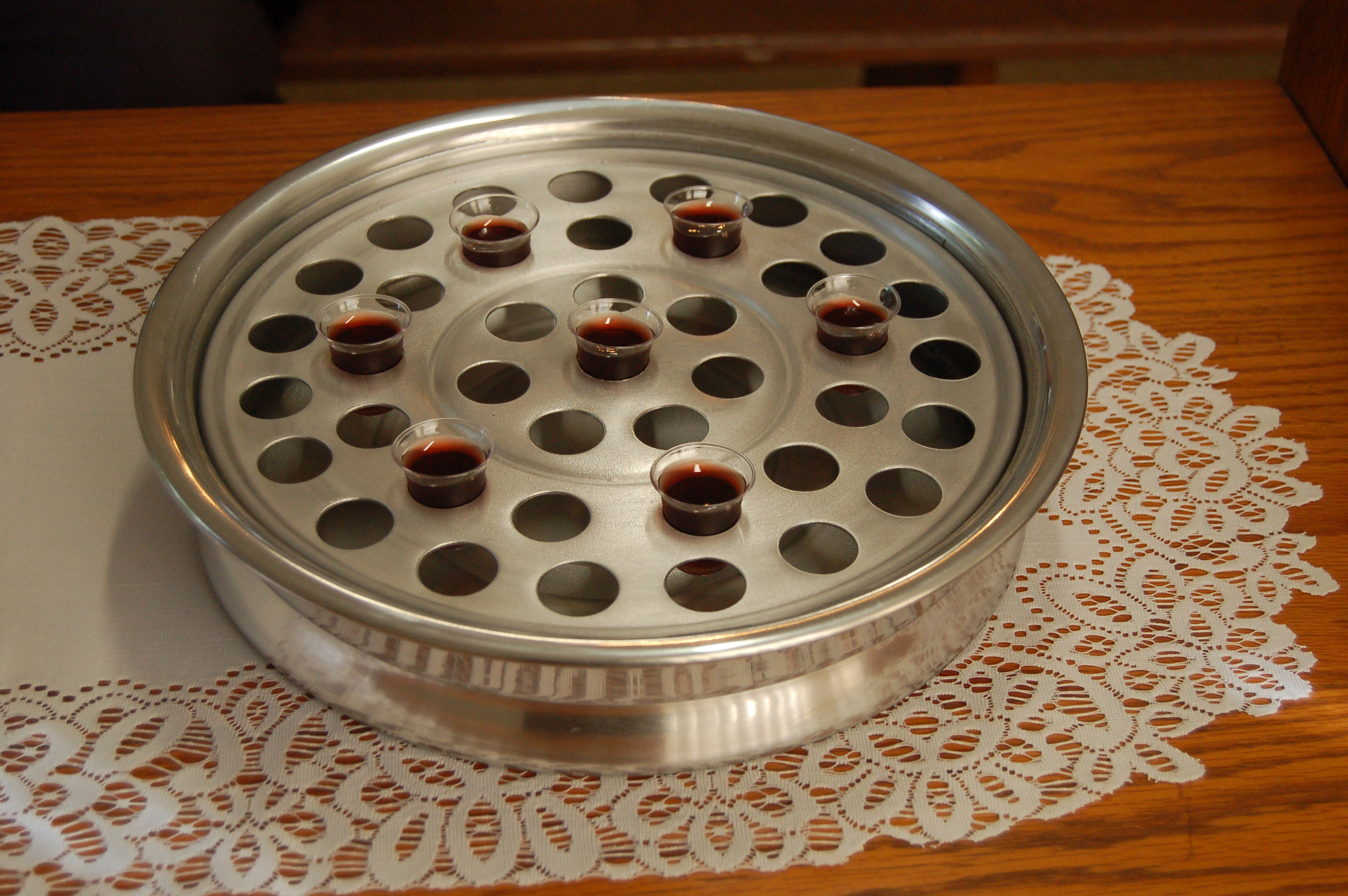 Christian Stock Photos by Linda Bateman - Communion Emblem Prepared - Fruit of the Vine - on Lace Doily