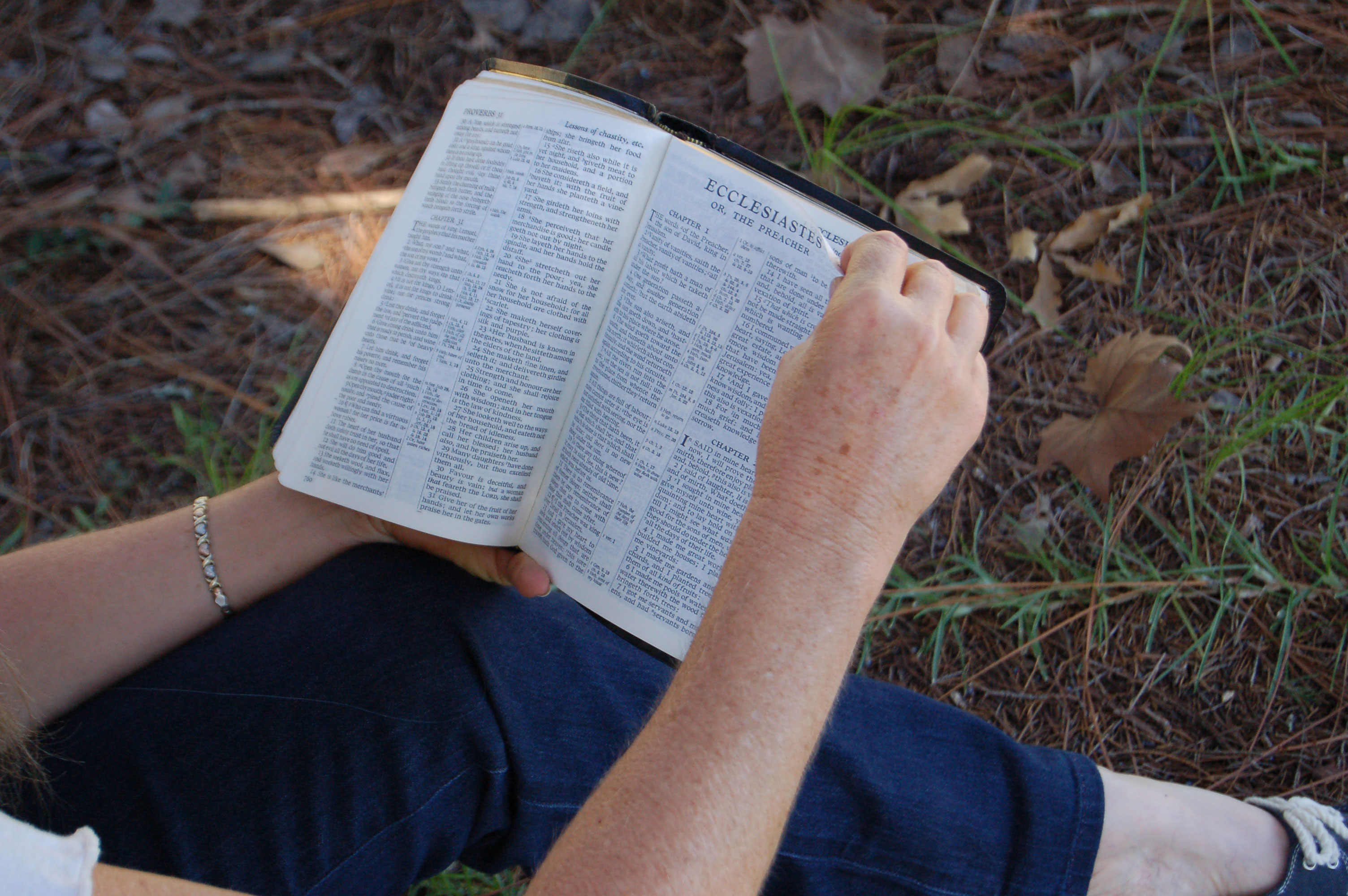 Christian Stock Photos by Linda Bateman - Woman Reading Bible Open to Ecclesiastes and Turning Page