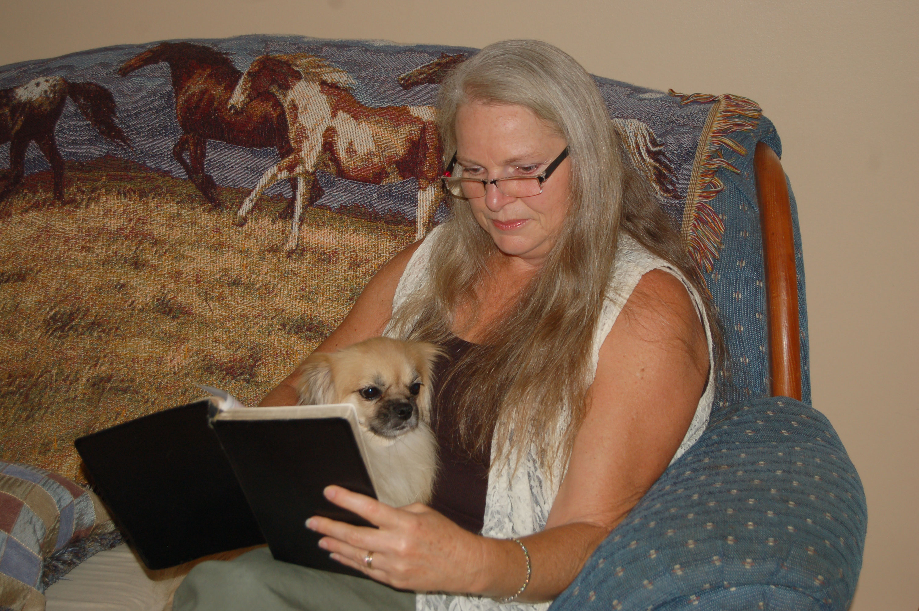 Christian Stock Photos by Linda Bateman - Woman Reading Bible while Sitting on Sofa, with Dog