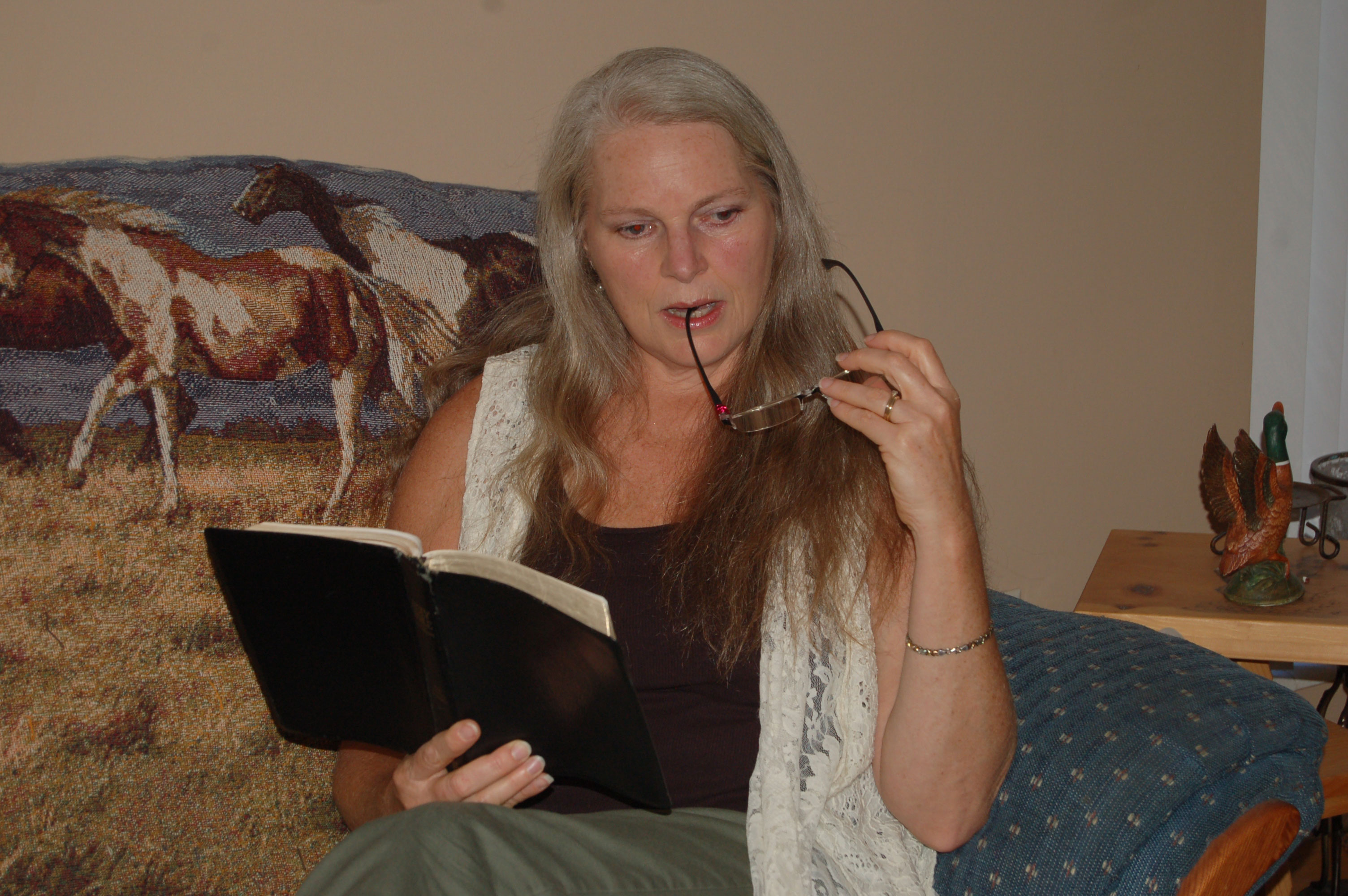Christian Stock Photos by Linda Bateman - Woman Thinking About Bible Passage While Sitting on Sofa