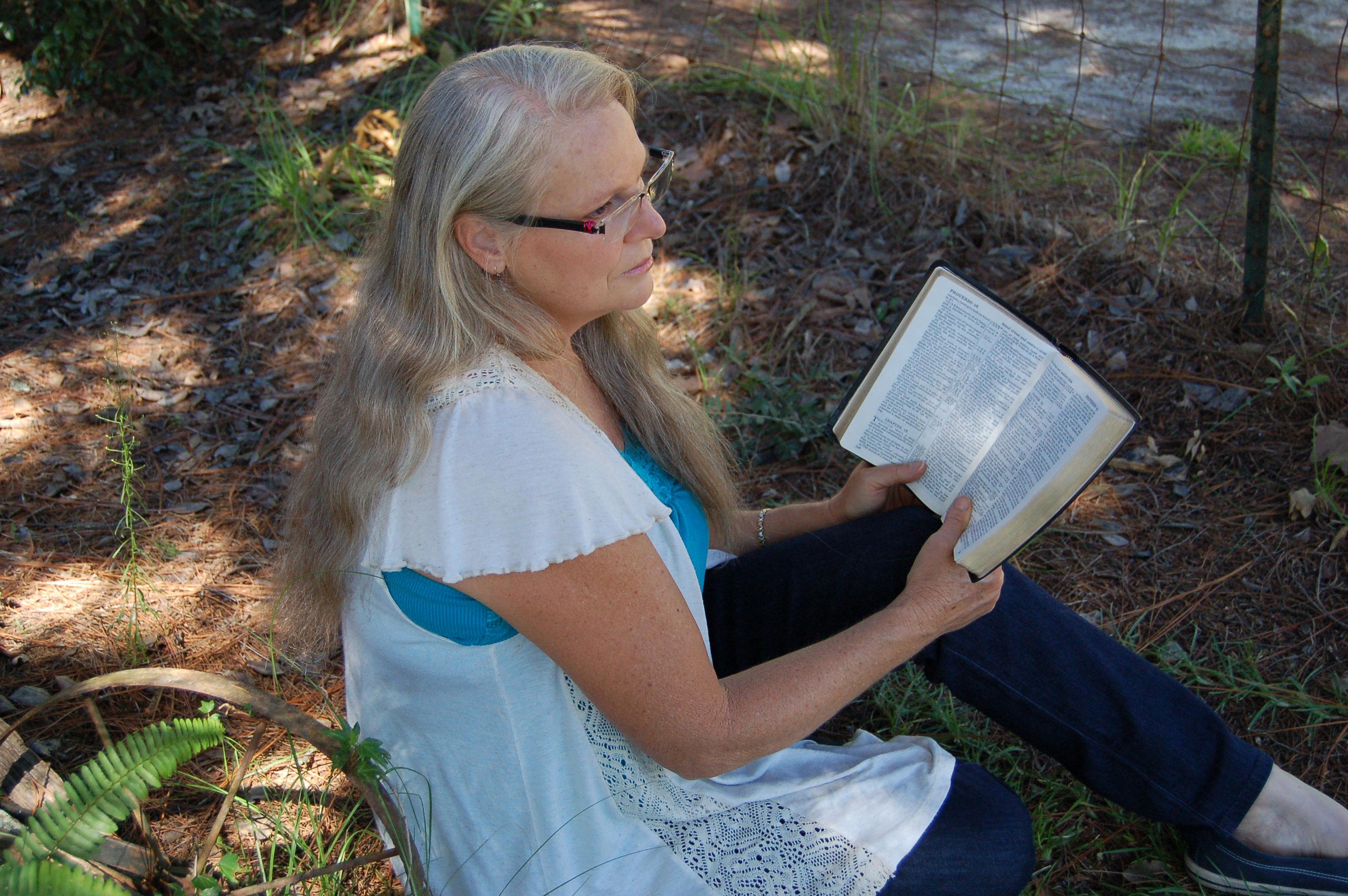 Christian Stock Photos by Linda Bateman - Woman Reading Bible Outdoors
