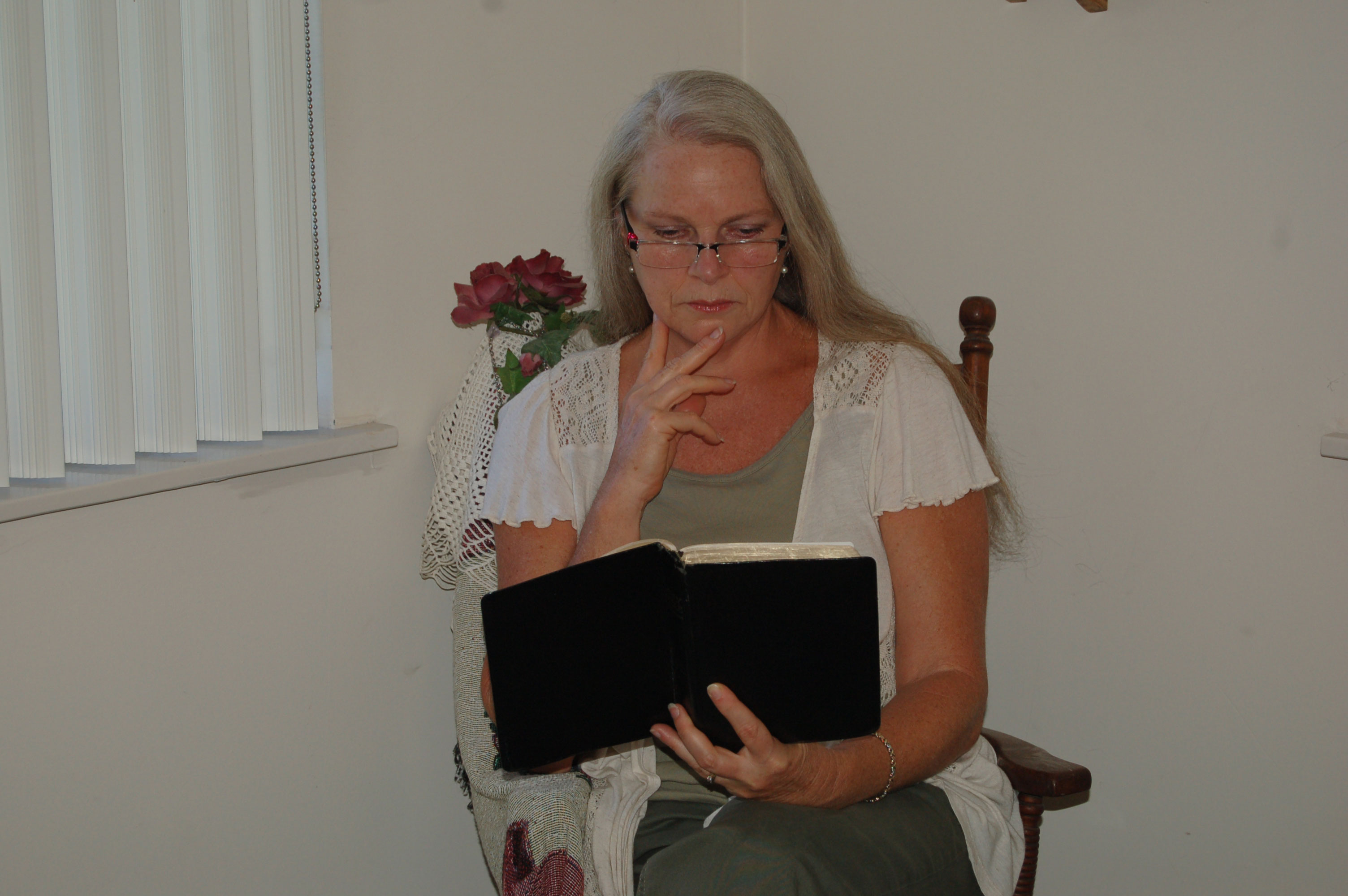 Christian Stock Photos by Linda Bateman - Woman Reading Bible while Sitting in Rocking Chair