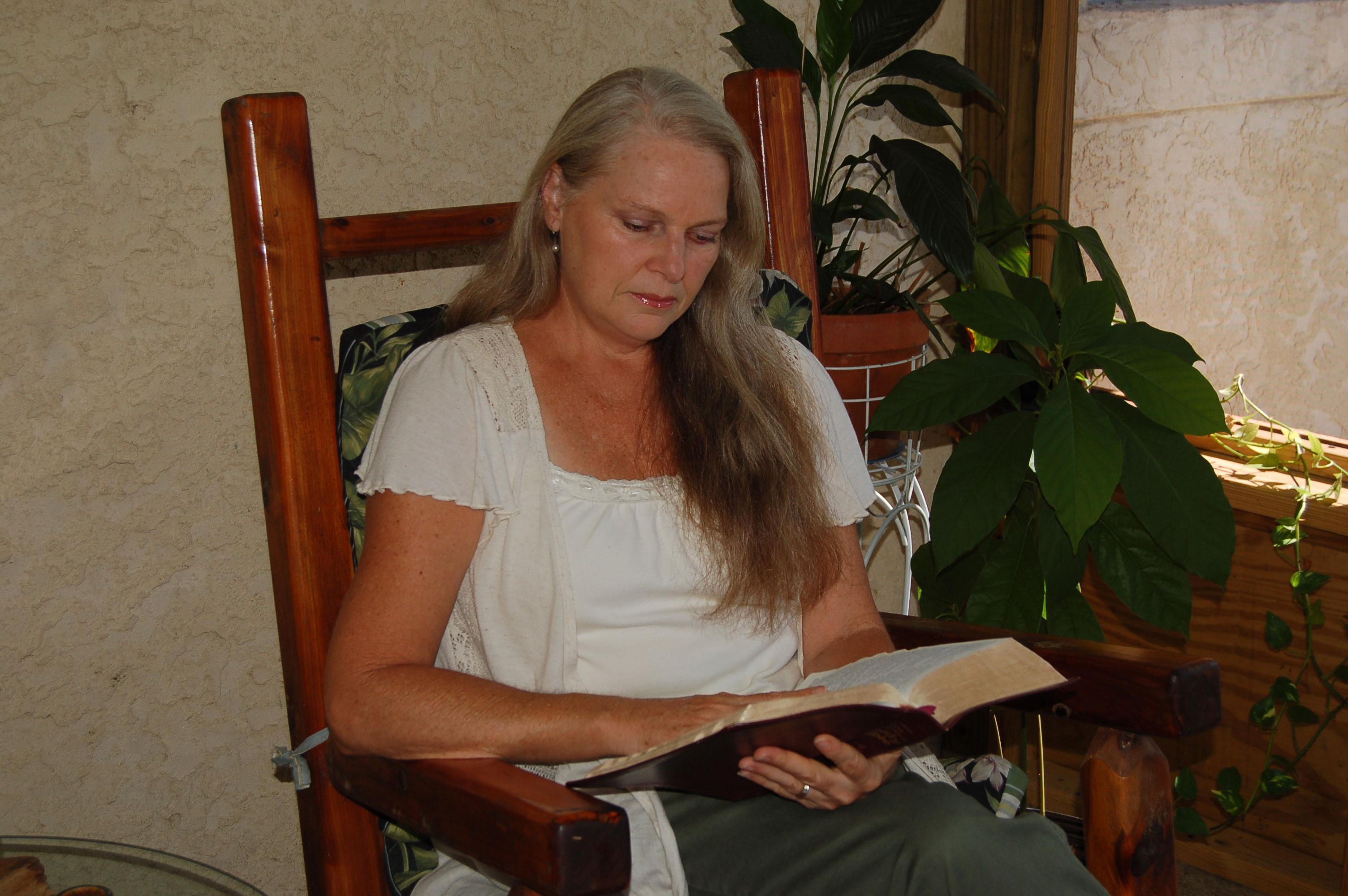 Christian Stock Photos by Linda Bateman - Woman Sitting in Rocking Chair Reading Bible